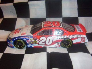 2003 NASCAR Action Racing Collectables . . . Tony Stewart #20  / Independence Day Chevy Monte Carlo 1/24 Diecast . . . Limited Edition 1 of 23,940