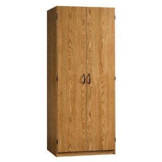 Shop Sauder Beginnings Wardrobe/Storage Cabinet in Oregon Oak Finish at the  Furniture Store. Find the latest styles with the lowest prices from Sauder