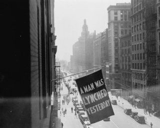 1936 photo Flag, announcing lynching, flown from the window of the NAACP head g5