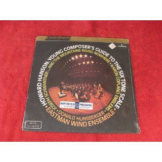Howard Hanson; Young Composer's guide to the six 6 tone scale; Eastman wind ensemble; Joseph Schwantner and the mountains rising nowhere; Aaron Copland; emblems; Donald Hunsberger; 1983 Vinyl LP: Music