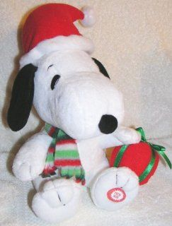 Peanuts Animated Musical Christmas Snoopy Doll with Santa Hat and Red Present: Toys & Games