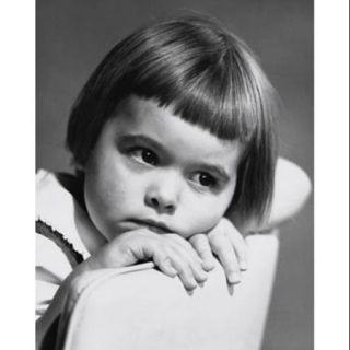 Close up of a girl looking sad Poster Print (18 x 24)