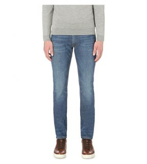 SLOWEAR   Faded wash slim fit tapered jeans